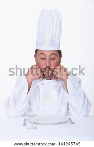 Male chef looks very unhappy
