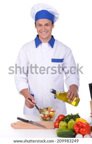 Male chef preparing salad. isolated on white background - stock photo