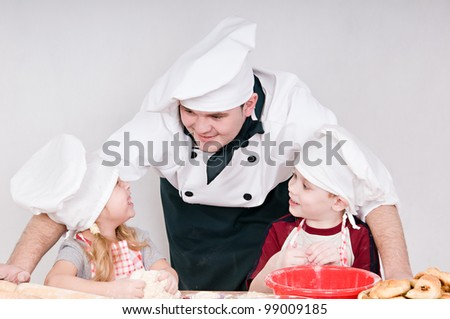 male chef tells the children something - stock photo