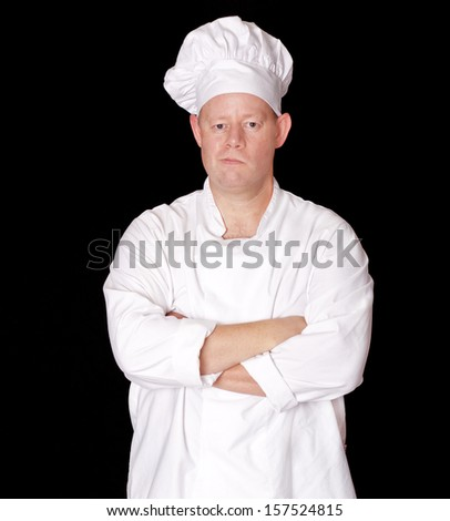 Male chef with a smirk on his face and arms crossed isolated  - stock photo