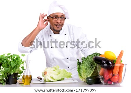 Male chef with fruits and vegetables on table, isolated on white background - stock photo