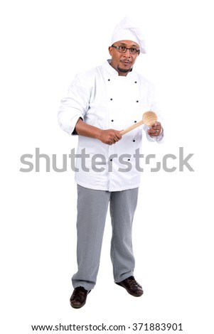 Male chef with wooden spoon isolated on white background - stock photo