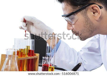 Male chemist with chemical liquid, shot indoor isolated on white background