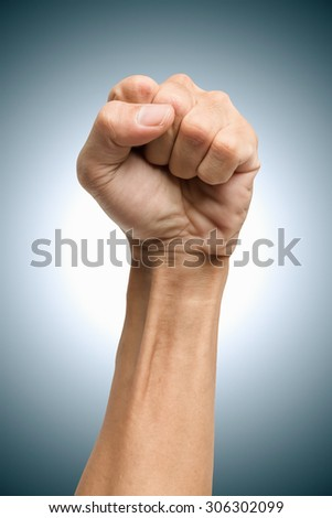 Male clenched fist, isolated on a white background - stock photo
