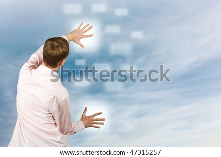 Male clicking on virtual buttons - stock photo