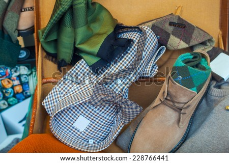 Male clothes. Shirt, scarf, shoes and bow tie in the clothes shop - stock photo
