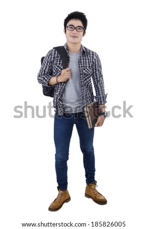 Male college student standing on white background - stock photo