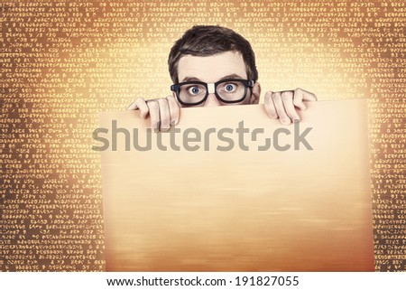 Male computer geek holding blank advertising copyspace sign. Technology sales and communications - stock photo