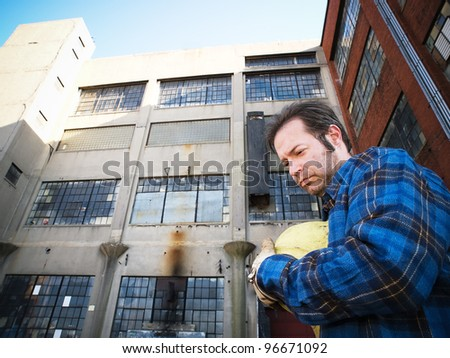 Male Construction Worker, forlorn, outdoors, out of work - stock photo