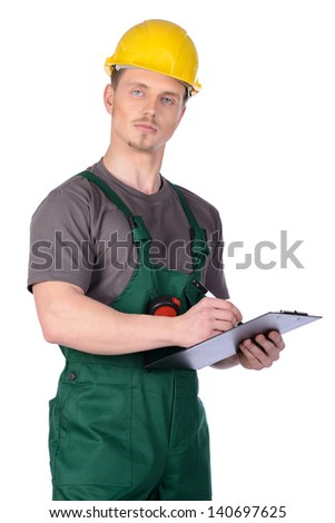 Male construction worker in overalls and helmet holding a clipboard. Isolated on white background. - stock photo
