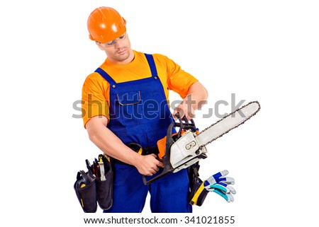 Male construction worker in uniform working with chainsaw. Job, occupation. Isolated over white.  - stock photo