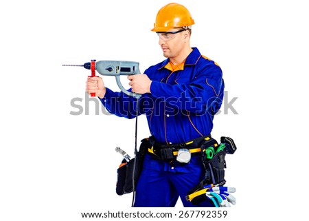 Male construction worker with a drill. Job, occupation. Isolated over white.  - stock photo