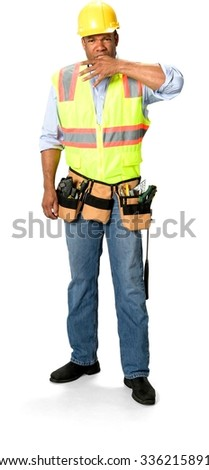 Male Construction Worker with short black hair in uniform hurt finger and put it into his mouth - Isolated - stock photo