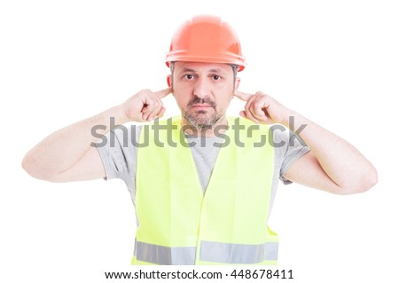 Male constructor doing hear no evil gesture with a serious expression on his face isolated on white background - stock photo