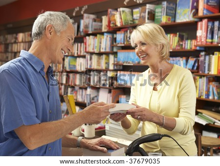 Male customer in bookshop - stock photo