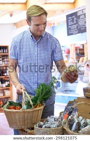 Male Customer Shopping In Farm Shop - stock photo