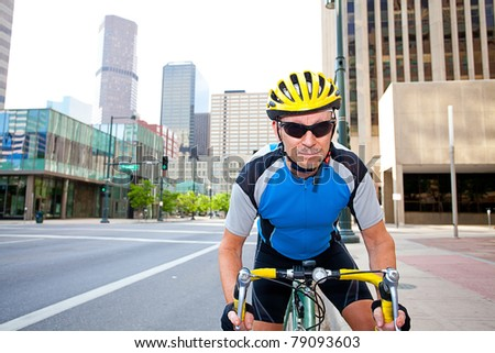 Male cyclist in downtown - stock photo