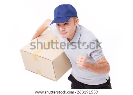 male delivery staff running, hand holding parcel or box for speedy service - stock photo
