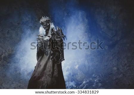 Male demon. Art studio shot. Goth necromancer with horror bodyart - stock photo
