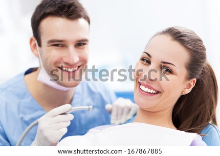 Male dentist and woman in dentist�s office - stock photo