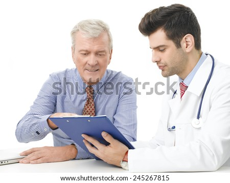 Male doctor and old patient analyzing result of the test while sitting against white background.  - stock photo