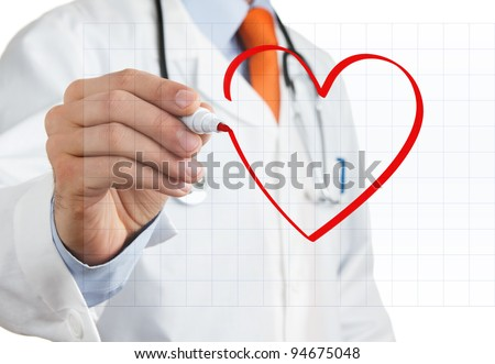 Male doctor drawing heart symbol at interactive whiteboard - stock photo