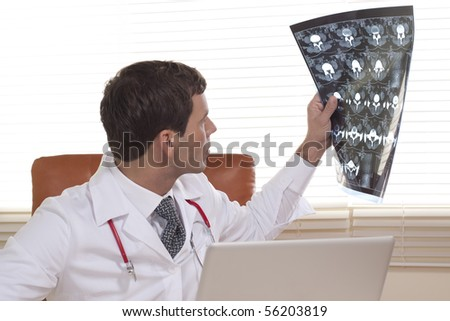 Male Doctor Examining CAT scan