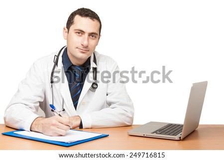 Male doctor filling out medical document - stock photo
