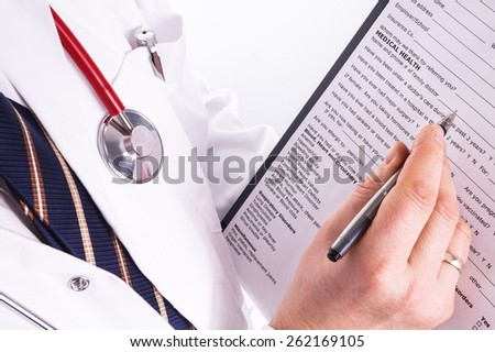 Male doctor fills patient registration prior to admission and examination. The doctor is thorough in completing properly so the patient gets the optimal treatment during his examination and illness - stock photo