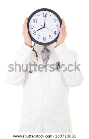 male doctor holding clock in front of face isolated on white background - stock photo