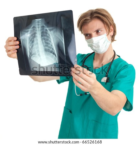 male doctor in protective mask reading x-ray chest, lungs - stock photo