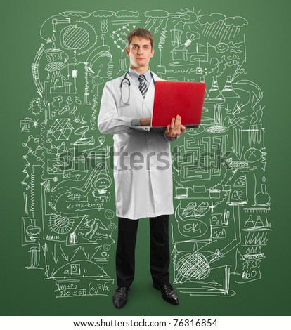 male doctor in suit with laptop in his hands, looking on camera