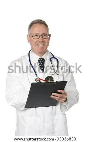 Male doctor isolated on white smiles as he takes notes on a clipboard - stock photo