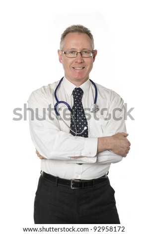 Male doctor isolated on white smiles directly at camera with arms crossed - stock photo