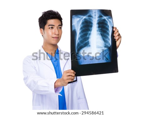 Male doctor look at the x ray - stock photo