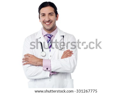 Male doctor posing with arms crossed - stock photo