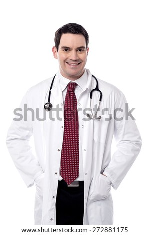 Male doctor posing with hands in his overcoat