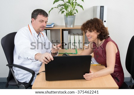 Male doctor receiving  woman from medical representative - stock photo