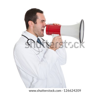 Male Doctor Shouting In Megaphone. Isolated On White