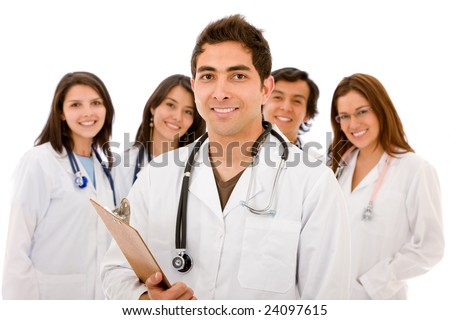 male doctor smiling standing with his  team behind him - isolated - stock photo