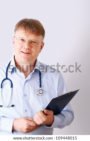 Male doctor standing with folder, isolated on white background