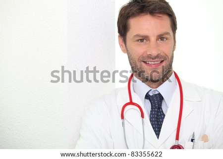 Male doctor stood smiling - stock photo