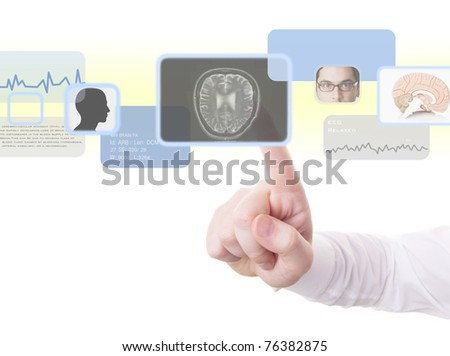 Male doctor using high technology to perform a medical examination of the brain (radiology, psychology, psychiatry, technology concept and more) - stock photo