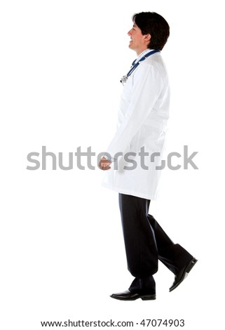Male doctor walking isolated over a white background -side view