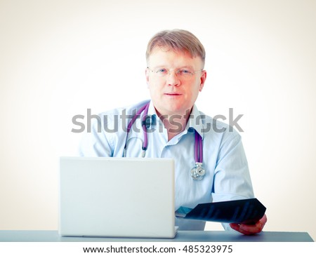 Male doctor working at a workplace, isolated on white background