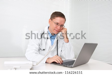 male doctor working on a laptop - stock photo