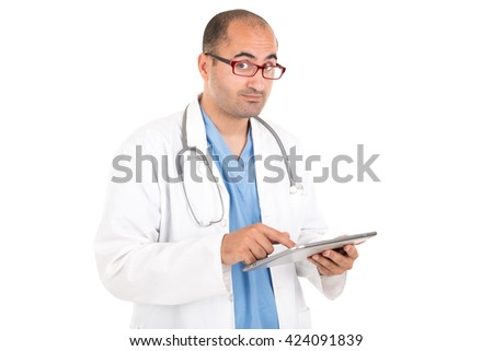 Male doctor working with a tablet isolated in white - stock photo