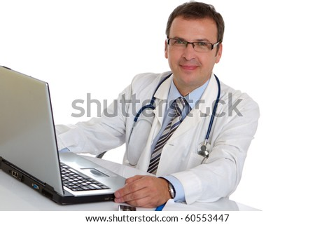 Male doctor write medical reports - at work use laptop - stock photo