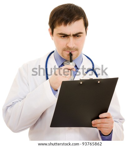 Male doctor writes on the document table on a white background.