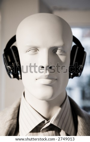 Male doll with headphones - stock photo